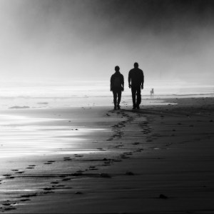couple walking on foggy beach